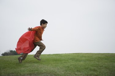 Boy running with cape
