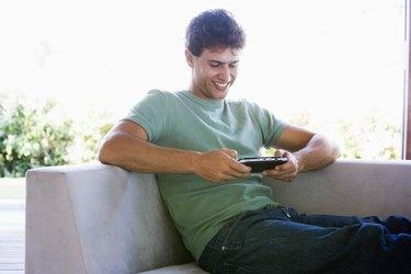 Man playing handheld video game