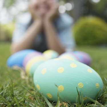 Boy and Easter eggs on lawn (focus on foreground)