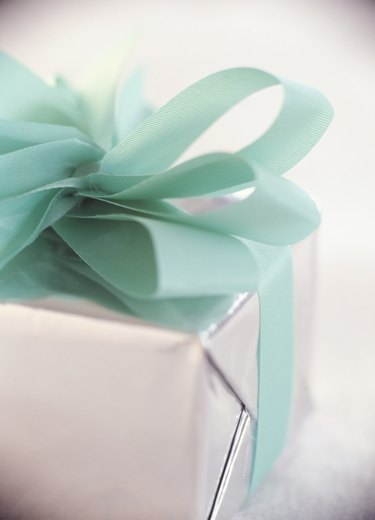 Christmas gift wrapped with bow, close-up