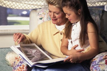 caucasian grandmother and child reading