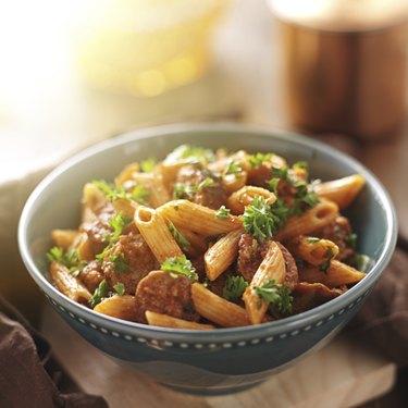 bowl of rigatoni pasta with sausage