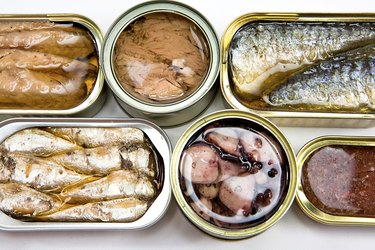 different tin cans isolated on white