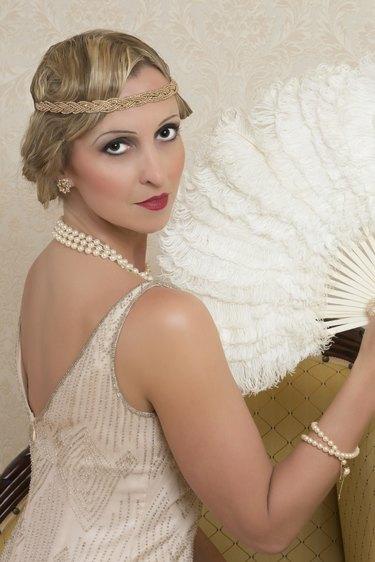 Vintage twenties lady wearing a headband and flapper dress