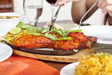Eating Indian Food Chicken Tandoori