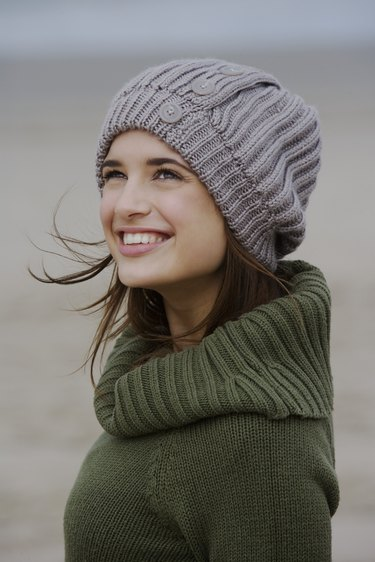 Woman in sweater and cap