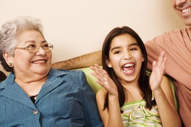 Girl (10-11) with grandmother, smiling