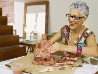 Close up of a senior woman sculpting