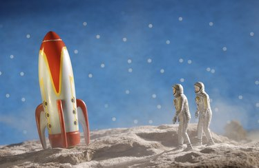 Astronaut figurines and toy rocket