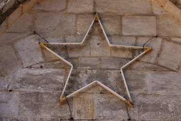 Star light hanging on stone wall
