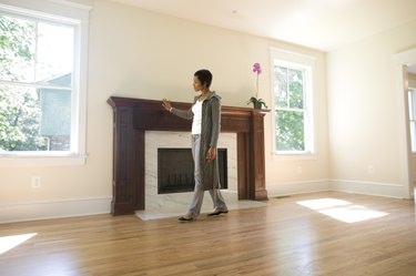 Woman admiring fireplace in her new home