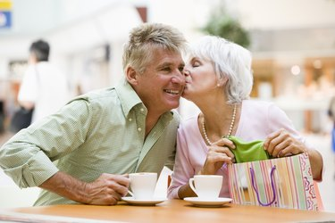 Affectionate couple having coffee at mall
