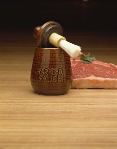 Raw steak and barbecue sauce