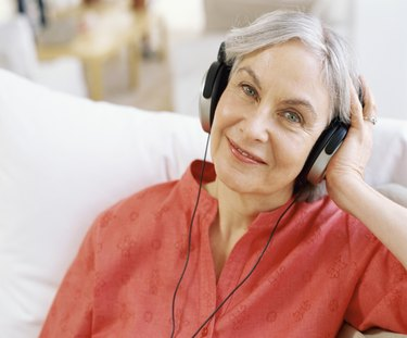 close-up of a senior woman wearing headphones