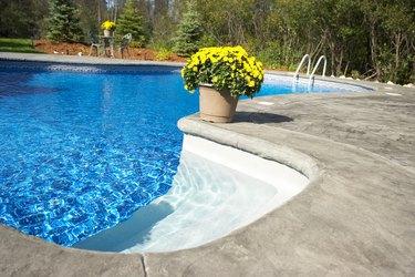 Flowerpot on edge of swimming pool