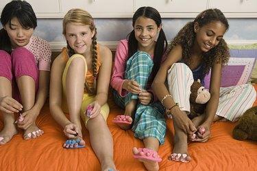 Girls painting toenails