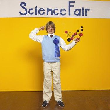 Boy with chemistry model
