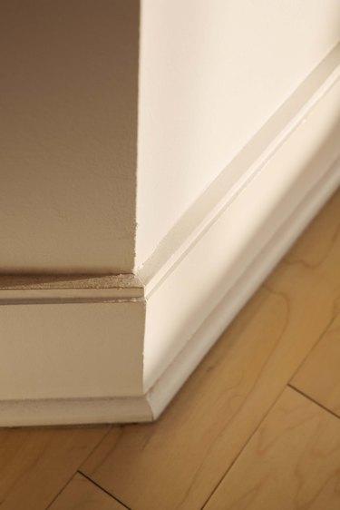 Baseboard and wooden floor