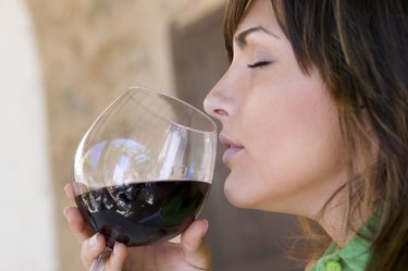 Woman smelling wine with eyes closed