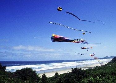 Kites flying on a beach