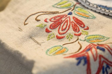 Embroidery of flowers on fabric
