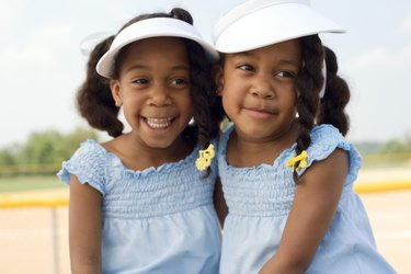 Twin girls embracing