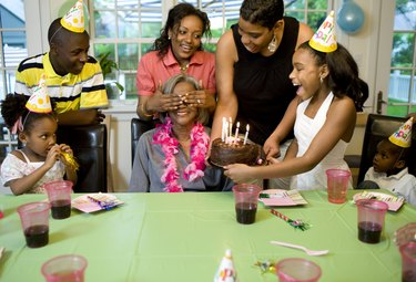 Family giving surprise party to grandmother