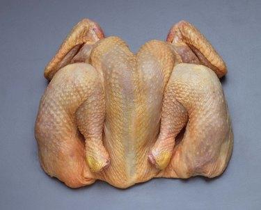 Butterflied raw chicken