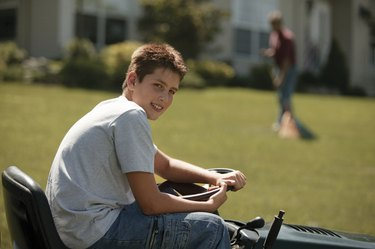 Boy on lawn mower