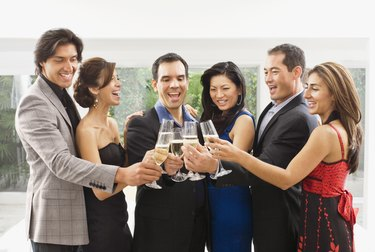 Multi-ethnic couples toasting with champagne