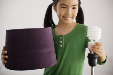 Girl holding lamp with CFB