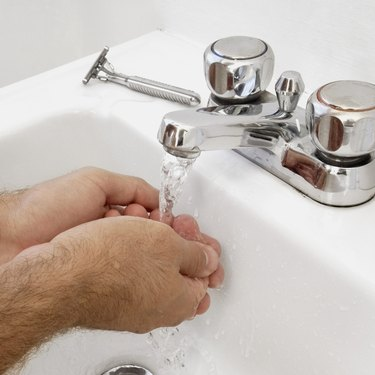 Close-up of man washing his hands, part of