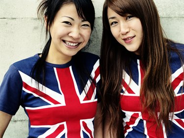 Two young women wearing Union Jack t-shirts, close-up, portrait