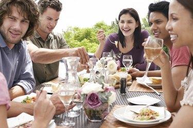 Friends Enjoying Dinner Party Outdoors