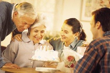 Senior woman celebrating her birthday with family