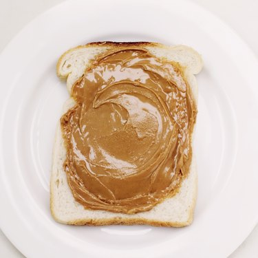 close-up of a slice of bread with peanut butter