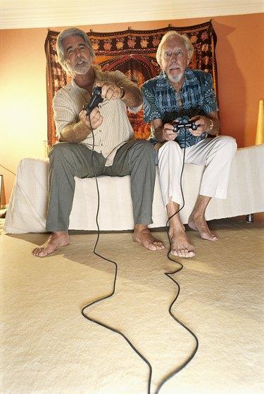 Mature men playing video game
