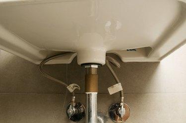 Plumbing underneath bathroom sink