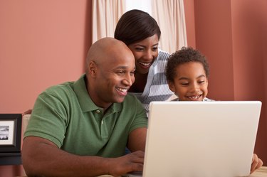 father and mother on laptop