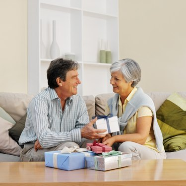 Side view of a mature man giving mature woman a gift