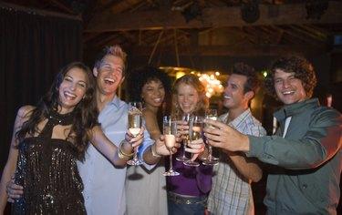 Friends with drinks in nightclub