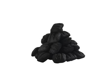 Heap of coal on white background