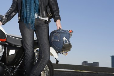 Woman motorcyclist with motobike