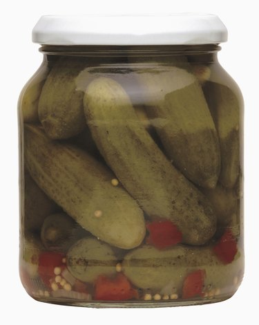 pickled cucumber and chilies in a closed jar
