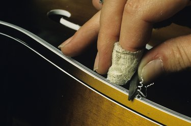 Hand carving wooden guitar, close-up