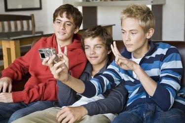 Teenage boys with digital camera