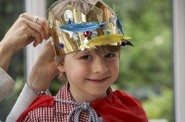 boy dressing up as king