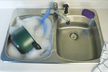Dishes in sink with suds
