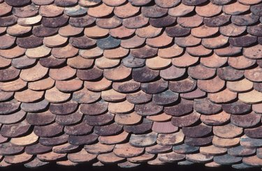 Overlapping roof tiles on building