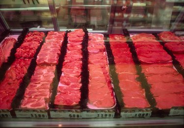 Assorted cuts of meat in butcher case